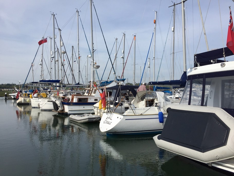 stern view of yachts moored in Island Harbour Marina